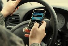 Utilizezi telefonul mobil în timp ce conduci în Marea Britanie?